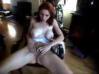 Redhead with great boobs masturbates