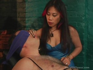 Mature Asian Dominatrix Sits Submissive Male on the Bondage Chair
