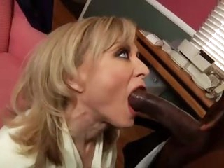 Slutty Nina Hartley with a dark stud