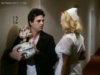 Hot Krystina Carson Wearing a Sexy Nurse Uniform - 'Apartment' Scene