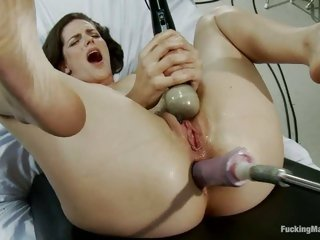 Slutty nympho couldn't help groaning as that babe gets banged by a fucking machine