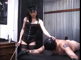 Dominatrix Beating Submissive Man's Ass