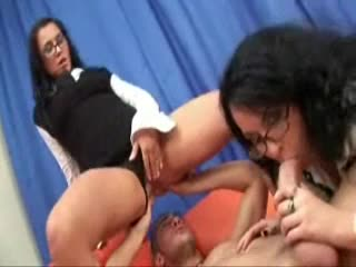 Cuties in glasses both have fun with his cock