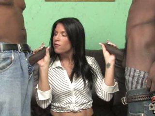 Kendra Secrets hot cougarl holding two black weenies