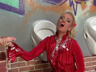 Dorina blond babe sucking a marital-device on the wall hole