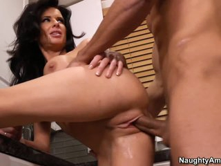 Veronica Avluv has a nice time with her son's buddy Marco Rivera in the kitchen. They are alone in this house and nothing can stop big titted dark brown woman from enjoying his cock in her mouth and pussy.