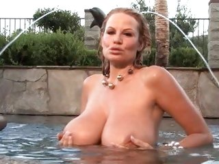 Blonde Kelly Madison gets wet in more ways than one
