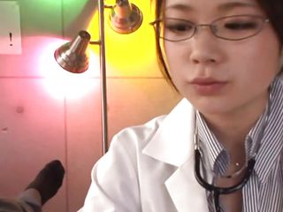 spectacled asian babe gives handjob to her patient