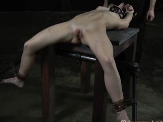 Disobedient girl is hypocritical on the table chained with gag in her mouth