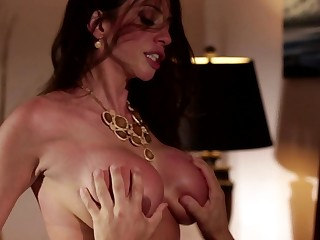 A hot babe with a nice rack is getting filled with cock in the bed