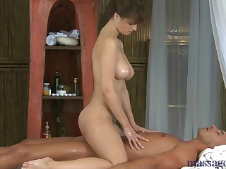 Sexy brunette does professional rub-down to her boss