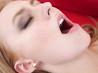 Cute kermis shakes her big ass for her man on the red sofa