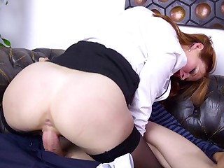 Two women are kissing each other while they are riding a dick