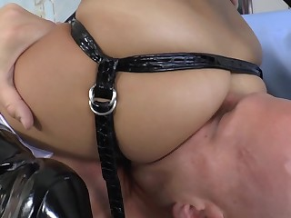 A prostitute with a strap on teases and fucks her male partner