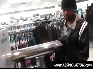 Lustful twink gets on his knees and sucks black dong in a store