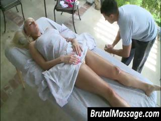 Sexy blonde babe gets a sexy oil massage on her sexy young body